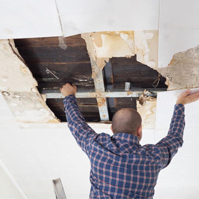 Drywall Repair at Work on Ceiling